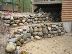 michigan granite fieldstone boulder retaining wall